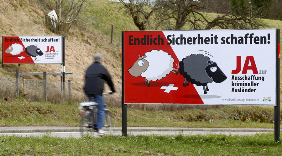 Posters of Swiss People's Party (SVP) demanding to deport criminal foreigners are displayed beside a road in Adliswil, Switzerland February 11, 2016. © Arnd Wiegmann