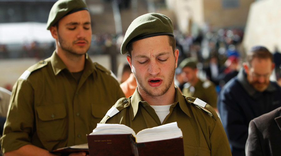 Israeli soldiers pray at the Western Wall, Judaism's holiest prayer site, in Jerusalem's Old City February 22, 2012. © Baz Ratner