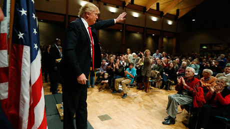 Republican presidential candidate Donald Trump leaves the podium after speaking at St Francis of Assisi church in West Des Moines, Iowa © Jim Bourg