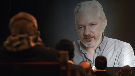 WikiLeaks founder Julian Assange (on then screen) takes part in a teleconference during the 2nd International Congress on Universal Jurisdiction in Buenos Aires on September 9, 2015 © Juan Mabromata