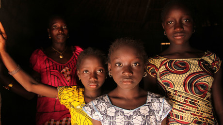 A woman and her daughters stand in their home, in the village of Cambadju in Bafatá Region. © unicef.org