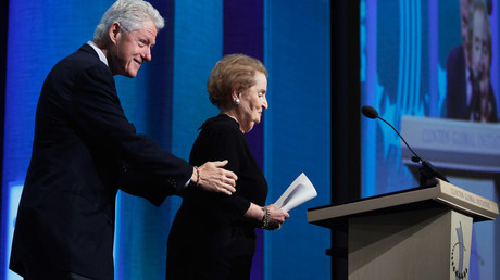 Former U.S. President Bill Clinton assists former U.S. Secretary of State Madeleine Albright at a 2010 event (file photo) © Lucas Jackson
