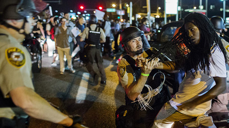 St Louis County police officers detain an anti-police demonstrator in Ferguson, Missouri August 10, 2015. © Lucas Jackson