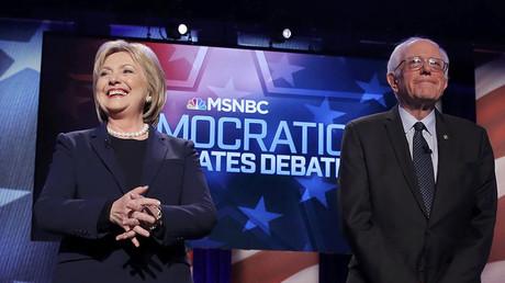 Democratic U.S. presidential candidates Hillary Clinton (L) and Bernie Sanders. ©Carlo Allegri
