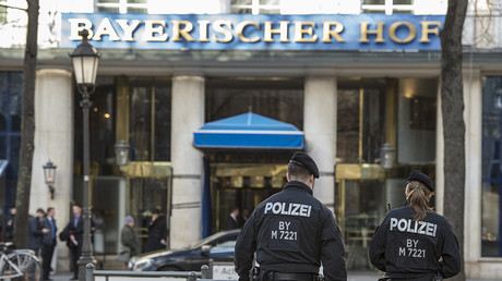Policemen walk in front of the Bayerischer Hof hotel, the location for the 52nd Munich Security Conference (MSC), in Munich, southern Germany, on February 11, 2016. © Thomas Kienzle