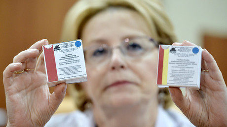 Russian Healthcare Minister Veronika Skvortsova demostrates Anti-Ebola fever vaccine packages at the Gamalei Research Institute of Epidemiology and Microbiology. © Ramil Sitdikov