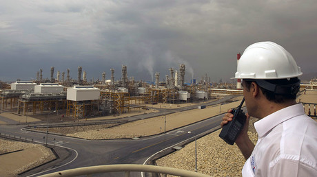 An engineer speaks on his radio at the Phase 4 and Phase 5 gas refineries in Assalouyeh, 1,000 km (621 miles) south of Tehran © Caren Firouz