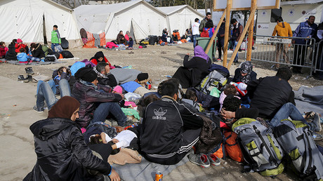 Migrants and refugees rest on the ground as they wait to continue their journey towards western Europe from the Macedonia-Serbia border at a transit camp in the village of Presevo, Serbia © Darrin Zammit Lupi