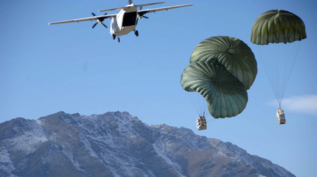 Blackwater CASA 212 over Afghanistan dropping supplies to U.S. Army soldiers. © soldiersmediacenter
