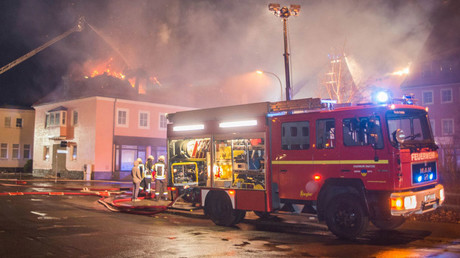 Fire fighters try to extinguish a fire at a former hotel that was under reconstruction to become a home for asylum seekers on February 21, 2016 in Bautzen east of Dresden © Rico Loeb