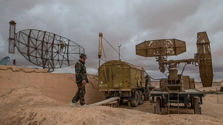 A Syrian soldier examines radar systems at the Syrian Air Force base in the Homs Province © Iliya Pitalev