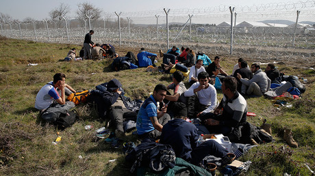 Migrants from Afghanistan who were sent back from the Serbian border rest next to a border fence at the Macedonian-Greek border in Gevgelija, Macedonia February 23, 2016 © Marko Djurica