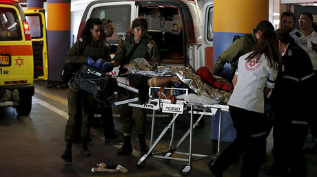 Medics evacuate a Palestinian man who was injured while carrying out a stabbing attack on an Israeli in the West Bank, at a hospital in Jerusalem February 24, 2016. © Ammar Awad