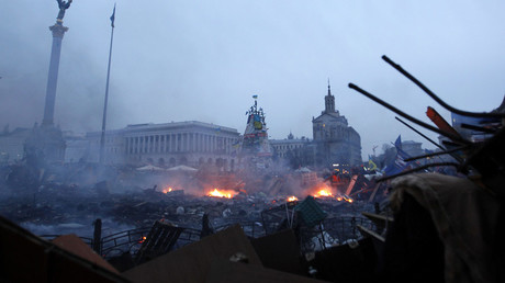 Fire and smoke are seen in Independence Square during a rally held by anti-government protesters in central Kiev February 19, 2014. © David Mdzinarishvili