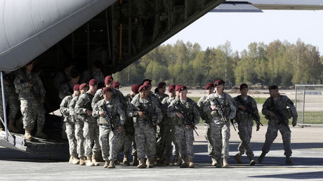 First company-sized contingent of about 150 U.S. paratroopers from the U.S. Army's 173rd Infantry Brigade Combat Team arrive in the airport in Riga. © Ints Kalnins