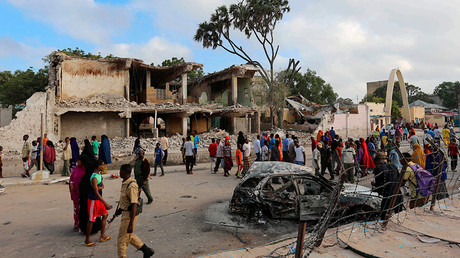 File photo: Residents gather to view the damage at the scene of a car bomb attack near Somali Youth League Hotel, known as SYL hotel, in Hamarweyne district in Mogadishu, February 27, 2016 © Feisal Omar