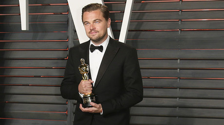 Actor Leonardo DiCaprio holds his award for Best Actor in the