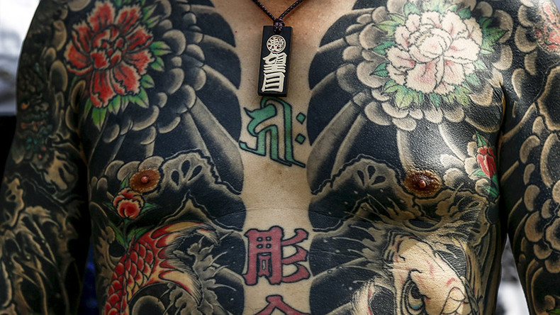 Yakuza war engulfs 10 japan prefectures official says for Japanese war tattoos