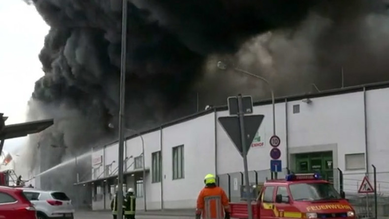 German factory engulfed in thick smoke after huge blaze