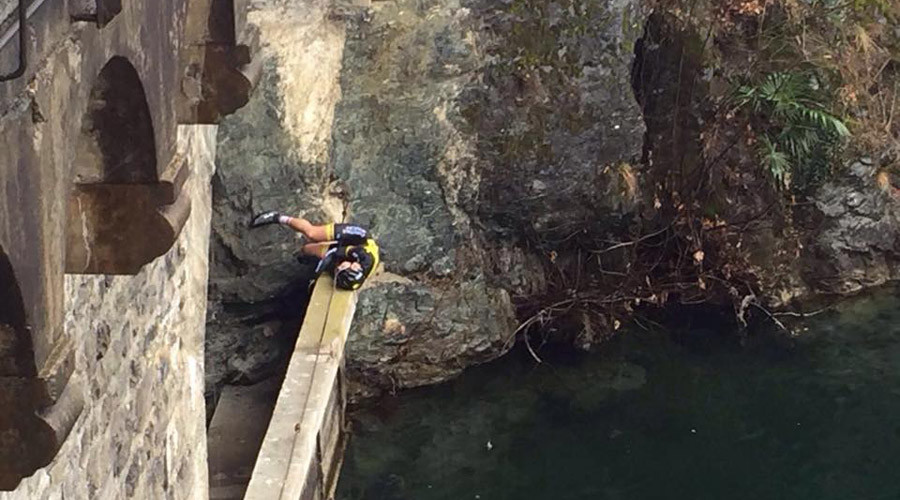 Lucky to be alive: Cyclist survives 39ft fall into freezing lake (PHOTOS)