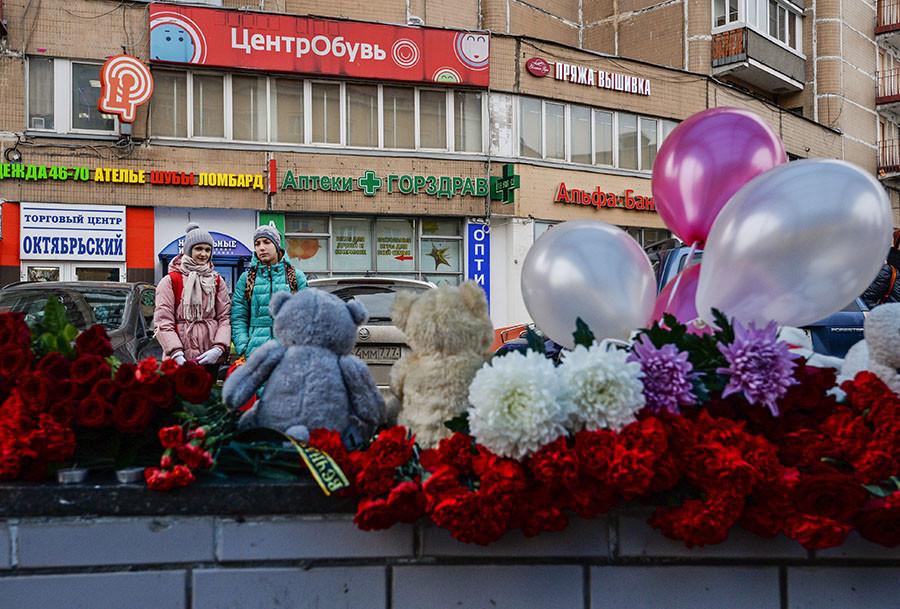 Flowers and toys in memory of slain four-year-old girl near Moscow's Oktyabrskoye Polye metro station. ©Eugene Odinokov