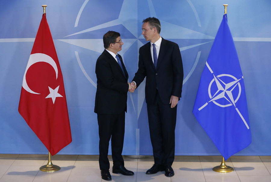 NATO Secretary General Jens Stoltenberg (R) shakes hands with Turkish Prime Minister Ahmet Davutoglu at the Alliance headquarters in Brussels, Belgium, March 7, 2016. © Francois Lenoir