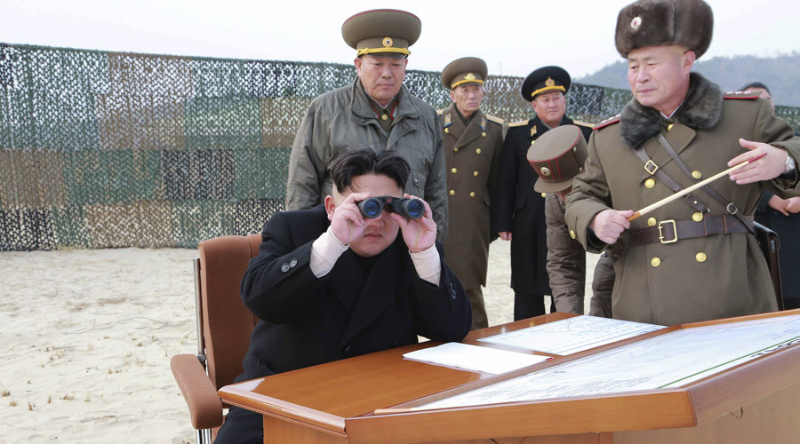 North Korean leader Kim Jong Un looks through a pair of binoculars as he guides the multiple-rocket launching drill of women's sub-units under KPA Unit 851, in this undated file photo released by North Korea's Korean Central News Agency (KCNA) in Pyongyang December 30, 2014. © KCNA