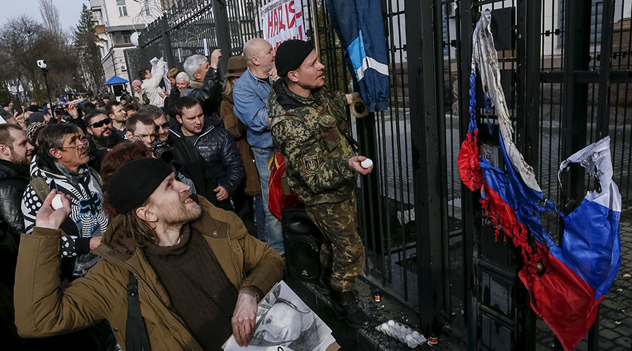Protesters throw eggs towards a building of the Russian embassy during a rally demanding the liberation of Ukrainian army pilot Nadezhda Savchenko by Russia, in Kiev, Ukraine, March 6, 2016. © Gleb Garanich