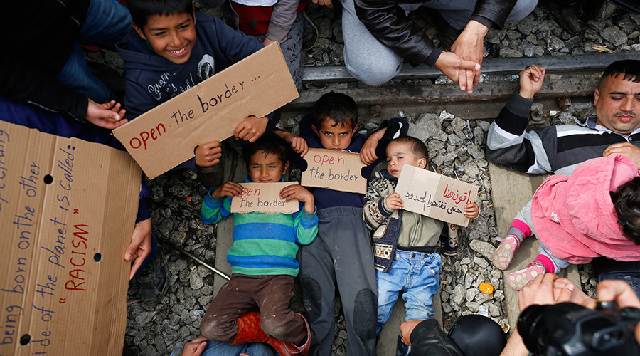 Refugee children laid on rails in Greek camp to protest closed border (VIDEO)