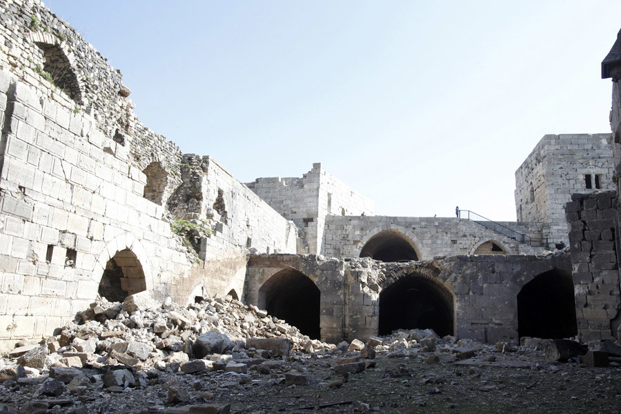 A view shows the damage inside the Crac des Chevaliers fortress in the Homs countryside, after soldiers loyal to Syria's President Bashar al-Assad  took control of it from rebel fighters, March 21, 2014. © Khaled Al Hariri