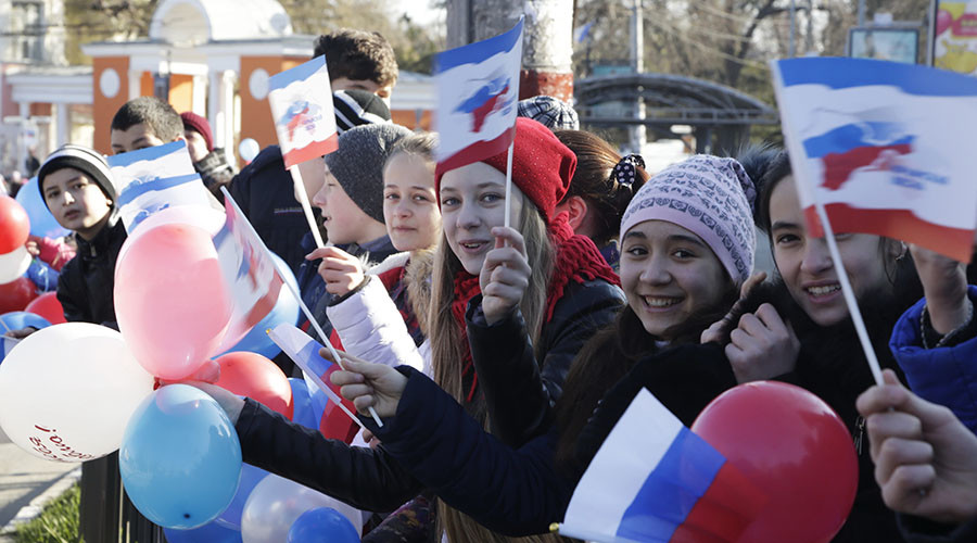 People take part in a rally marking the second anniversary of Crimea voting to leave Ukraine and join the Russian state in central Simferopol on March 16, 2016. © Max Vetrov