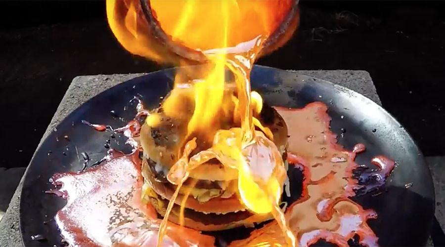 Molten copper struggles to break down Big Mac, stunning the internet (VIDEO)