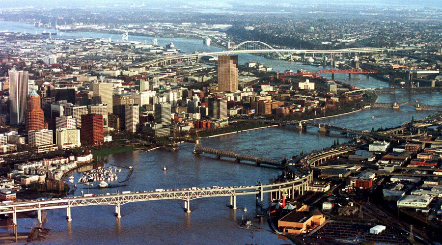 The rising floodwaters of the Willamette River threaten the city of Portland as it winds its way through the downtown core, February 9, 1996. File photo. © Jeff Vinnick