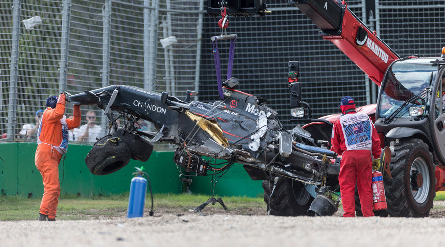 The McLaren of F1 driver Fernando Alonso is retrieved following a crash with Haas F1 driver Esteban Gutierrez at the Australian Formula One Grand Prix in Melbourne. © Reuters