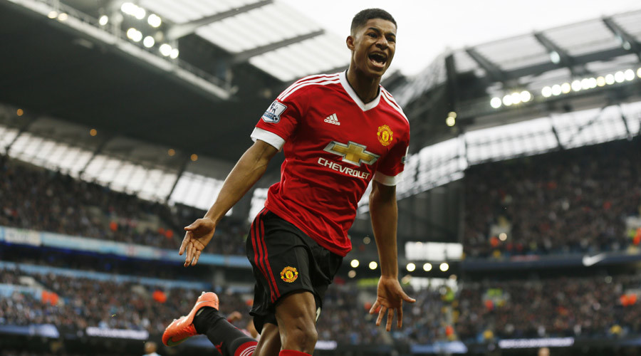Manchester United's Marcus Rashford celebrates after scoring a goal against Manchester City  © Jason Cairnduff