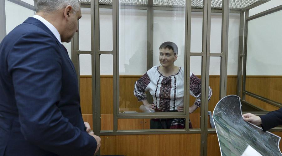 Former Ukrainian army pilot Nadezhda Savchenko listens to her lawyers Mark Feygin © Sergey Pivovarov