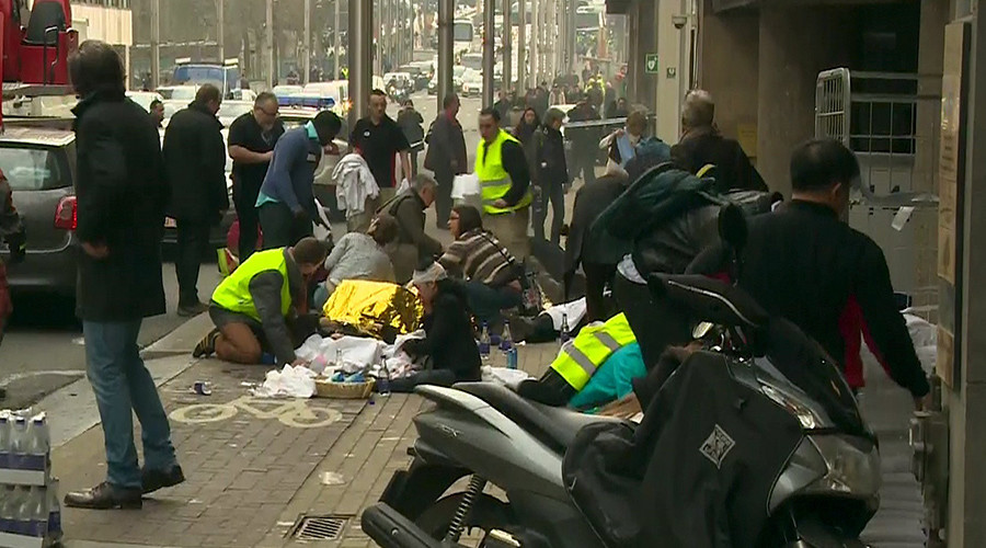 Rescue workers treat victims outside the Maelbeek metro station after a blast, in Brussels, Belgium on March 22, 2016 video © RTL Belgium