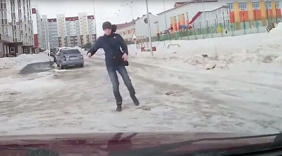 Old man takes on extreme winds… & loses (VIDEO)