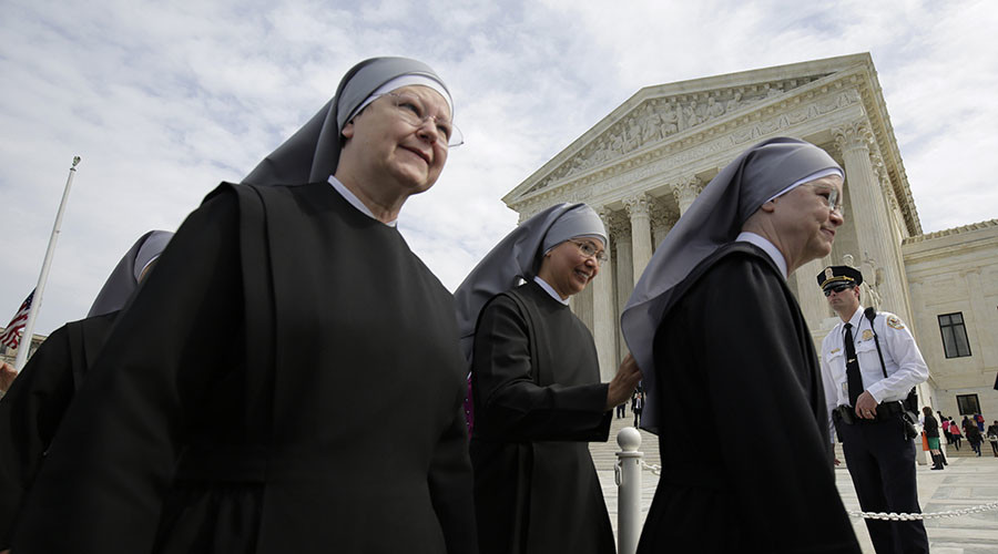 Nuns with Little Sisters of the Poor walk after Zubik v. Burwell, an appeal brought by Christian groups demanding full exemption from the requirement to provide insurance covering contraception under the Affordable Care Act was heard by the U.S. Supreme Court in Washington March 23, 2016. © Reuters