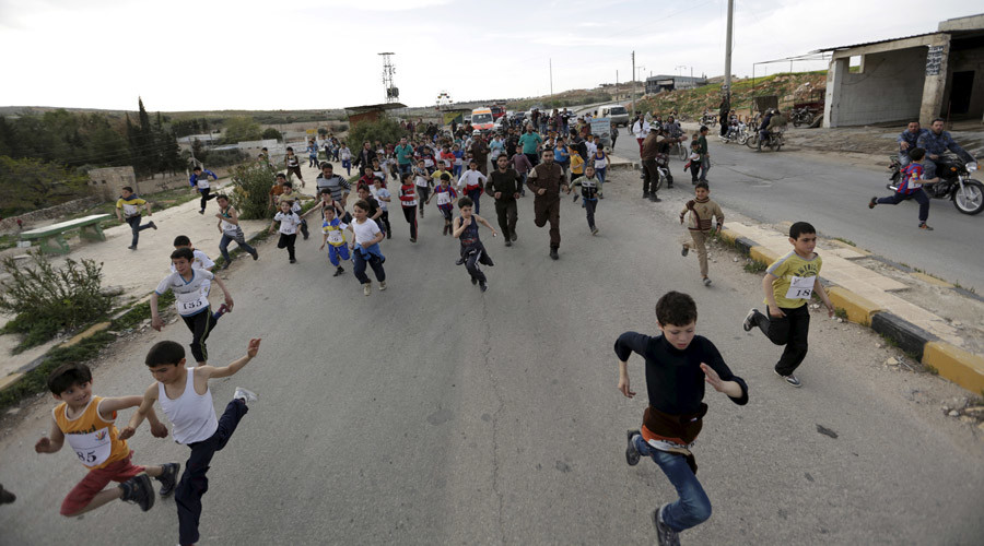 "Children run while competing in ""Freedom Marathon"" marking the fifth anniversary of the Syrian crisis, in the town of Marat Numan in Idlib province, Syria, March 23, 2016. © Khalil Ashawi"