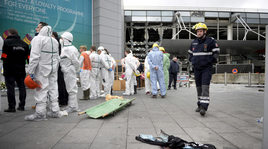 Rescuers attends a ceremony outside the terminal at Brussels International airport following bomb attacks in Brussels metro and Belgium's airport of Zaventem, Belgium, March 23, 2016. © Yorick Jansens
