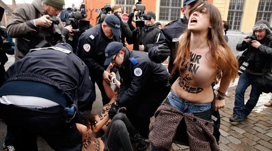 Police arrest topless FEMEN activists as Dominique Strauss-Kahn arrived at his trial on February 10, 2015. © Pascal Rossignol