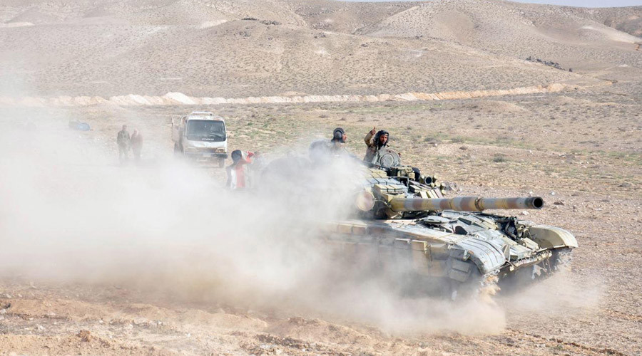 Forces loyal to Syria's President Bashar al-Assad drive a tank during their offensive to recapture the historic city of Palmyra in this picture provided by SANA on March 24, 2016.  © SANA