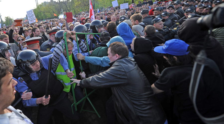 Police officers force back protesters during the March of Millions rally on Moscow's Bolotnaya Square.05.06.2012 © Vladimir Astapkovich