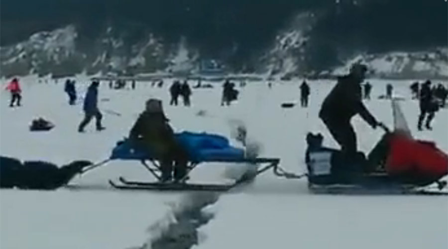 Dramatic escape for Russian fishermen as frozen lake cracks underfoot (VIDEO)