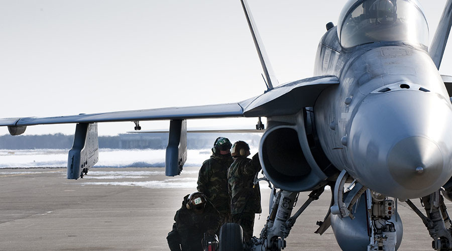 A ground crew from Strike Fighter Squadron 94, based out of NAS Lemoore, prepares an F/A-18C Hornet in this 2010 file photo © Staff Sgt. Samuel Morse, USAF, US Department of Defense