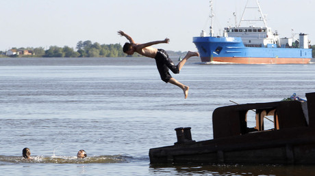 A boy jumps into the Volga River in the village of Ikryanoye outside Russia's southern city of Astrakhan © Sergei Karpukhin