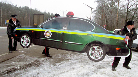 File photo: Ukrainian policemen install the first wooden police car imitation by the