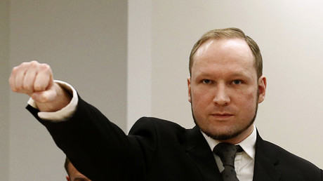 Norwegian mass killer Anders Behring Breivik gestures as he arrives in the court room at Oslo Courthouse August 24, 2012. © Heiko Junge / NTB Scanpix