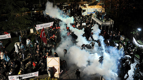 Riot police use tear gas to disperse protesting employees and supporters of Zaman newspaper at the courtyard of the newspaper's office in Istanbul, Turkey, late March 4, 2016. © Selahattin Sevi